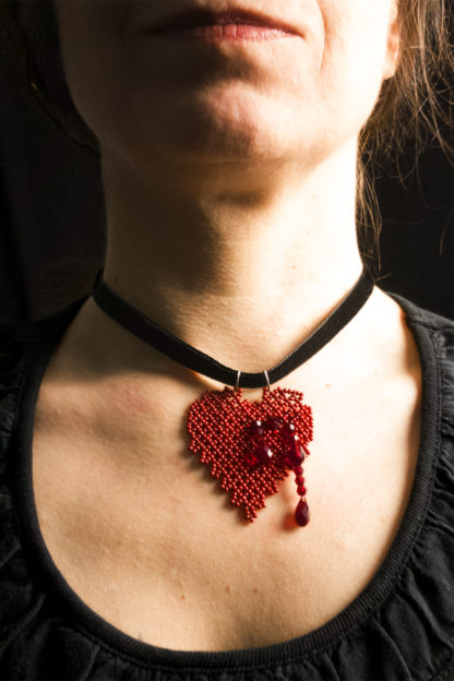 Model wearing the Bleeding Heart Pendant Necklace | Blood-Drenched Lace Collection by ChrisCrafting