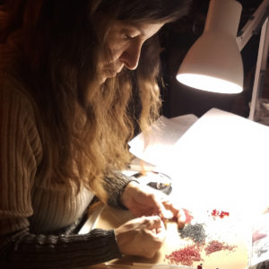 "Christine ""Chris"" Berni of ChrisCrafting working on new jewelry at her beading desk"